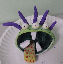 We made pinch pot monsters out of clay. We painted them the following day.